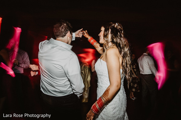 Upbeat indian bride and groom reception dance.