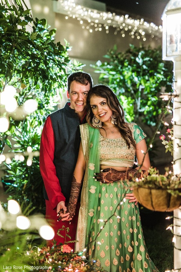Indian bride and groom at sangeet photo session.