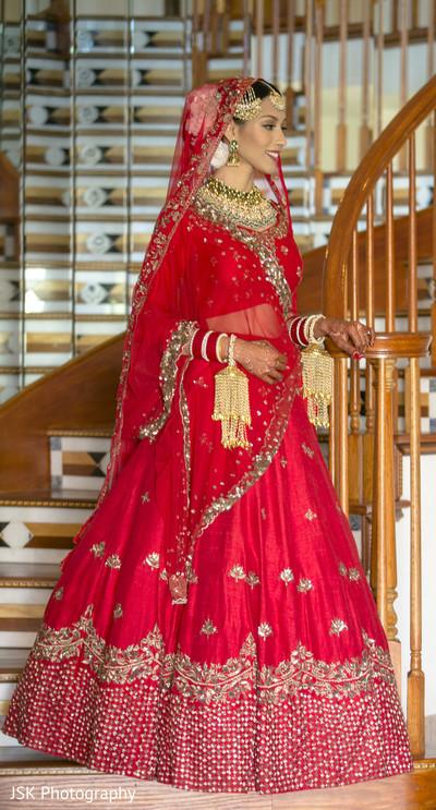 Maharani in her red lehenga and golden kalire.