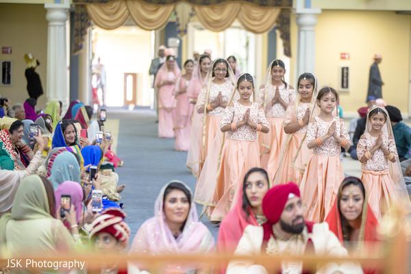 Indian flower girls in their peach gowns.