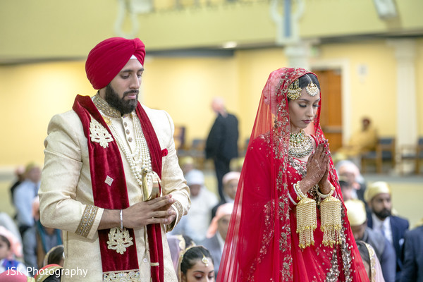 Indian bride and groom making their prayers.