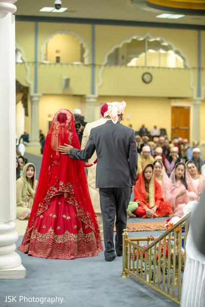 Indian bride walking behind groom ritual.