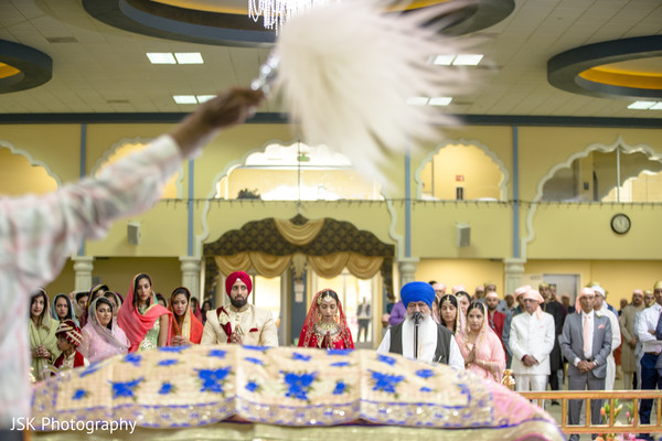 Indian couple at traditional sikh wedding ceremony.