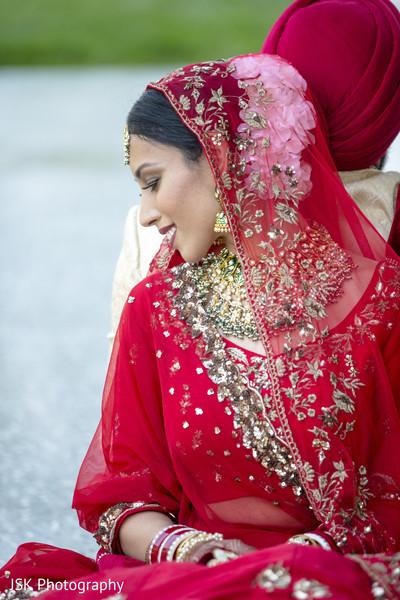 Indian bride  wearing her red ghoonghat.
