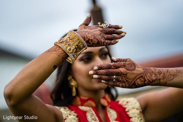 Gorgeous maharani showcasing her Mehndi during the photoshoot