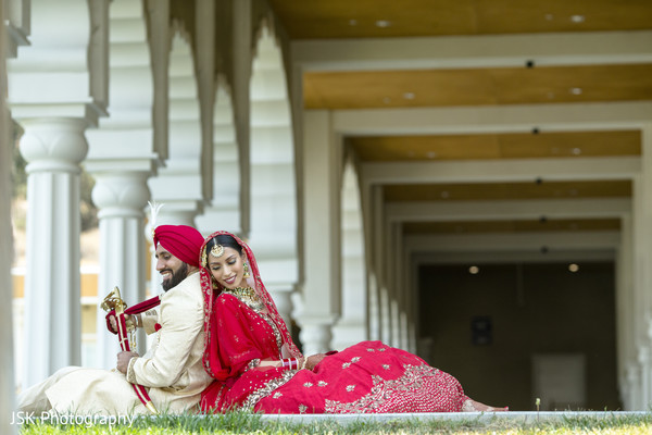 Indian couple posing outdoors.