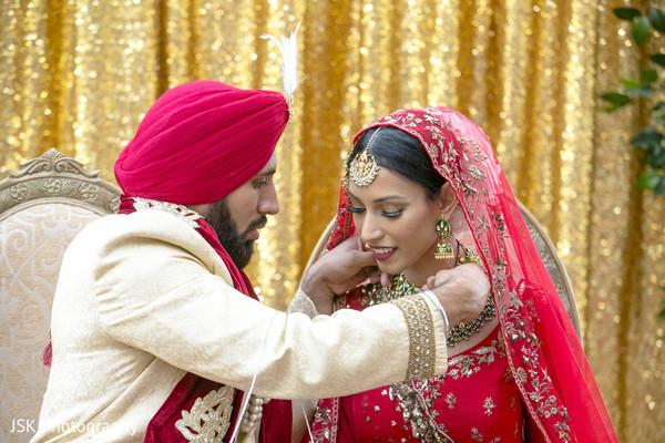 Indian groom putting the chain ritual.