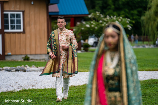 Groom approaching his bride during first look photoshoot
