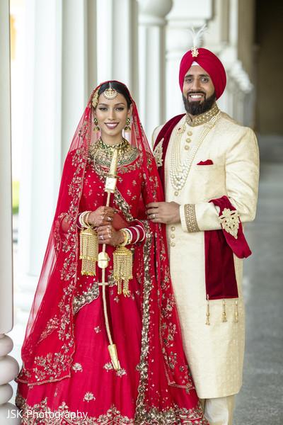 Indian bride holding Raja's sword.