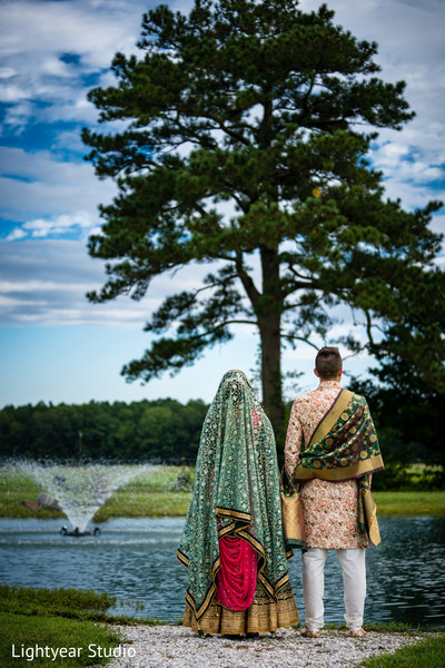 Bride and groom looking to the horizon during outdoor photoshoot