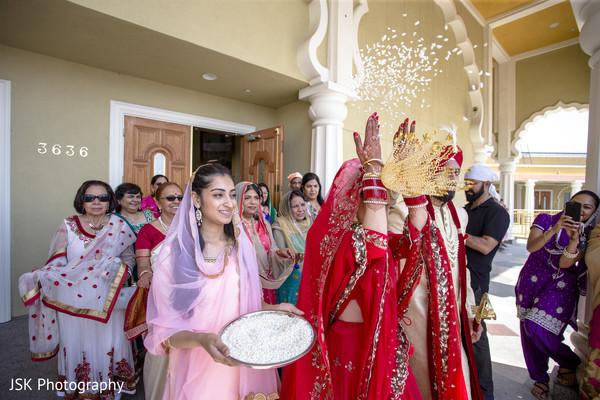Indian bride at wedding ceremony vidaai ritual .