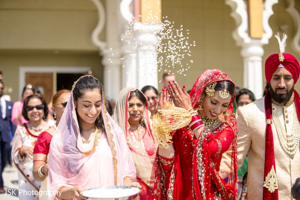 Indian bride throwing rice back.