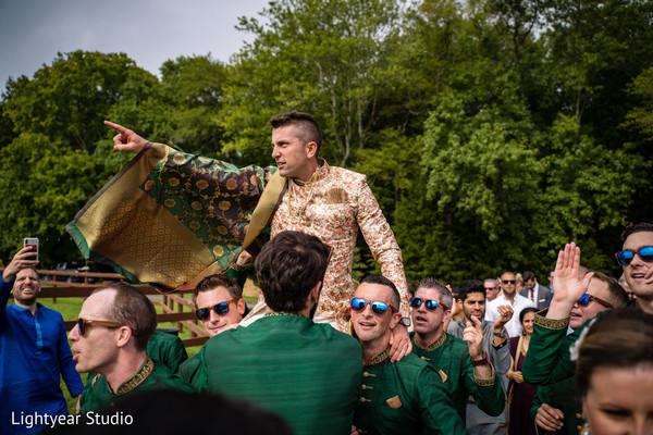 Groom having fun during Baraat procession
