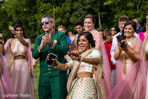 Guest having fun during baraat procession