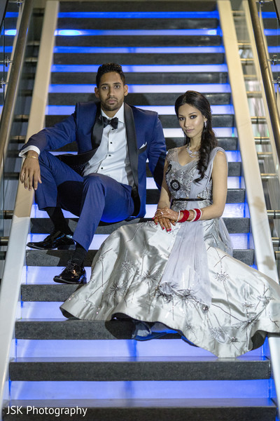 Indian couple sitting on stairs photo session.