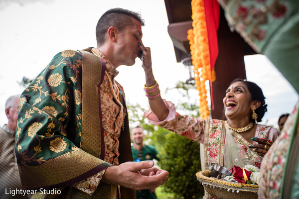 Groom meeting the bride's family during the baraat arrival