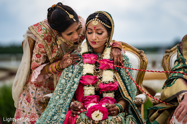 Lovely bride wearing a garland necklace during the wedding ceremony