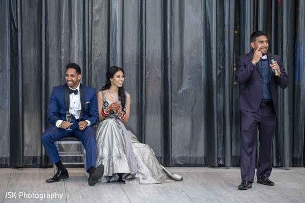 Indian groomsmen at reception speech.
