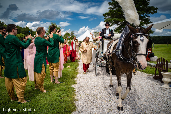Bride and groom leaving wedding ceremony in a carriage