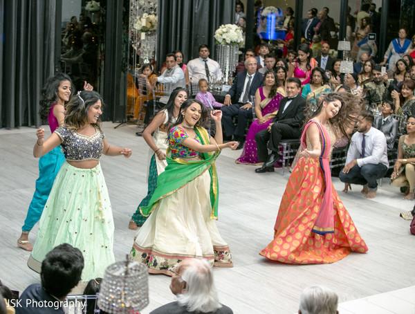 Indian bridesmaids at reception choreography.
