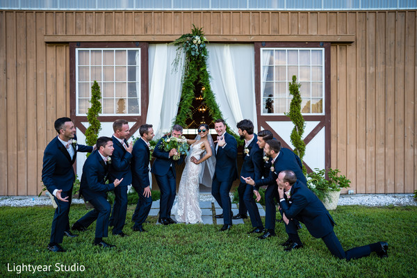 Lovely couple with groomsmen fun capture