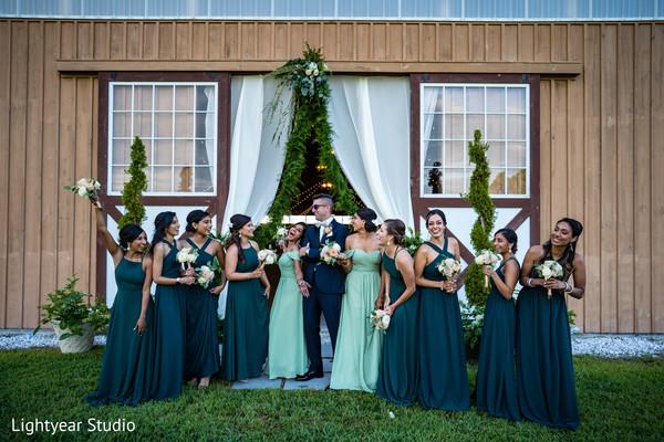 Groom having fun with bridesmaids
