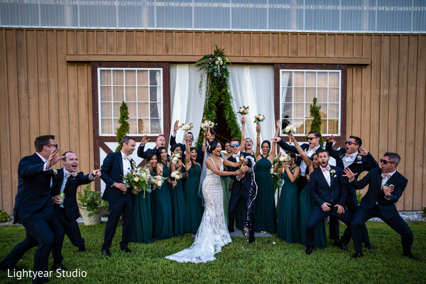 Bride and groom pop up a bottle of champagne