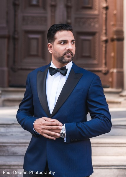 Handsome groom posing on her elegant tux during photoshoot