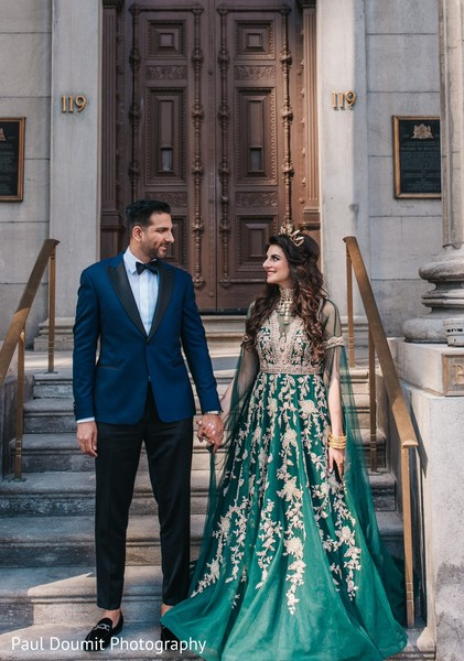 Sweet capture of bride and groom holding hands during photoshoot