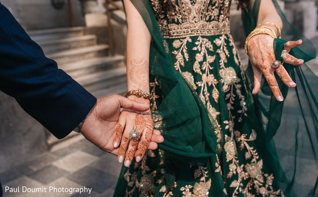 Sweet close up shot of Indian couple holding hands.