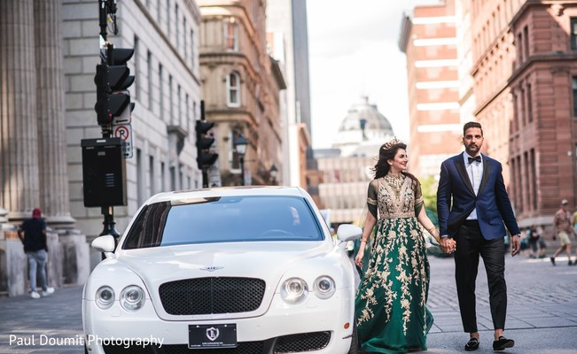 Dazzling Indian bride and groom walking in the city