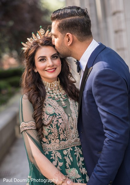 A romantic moment between Indian bride and groom during the phtoshoot