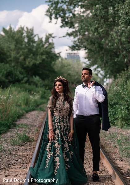 Elegant Indian couple posing during outdoor photoshoot