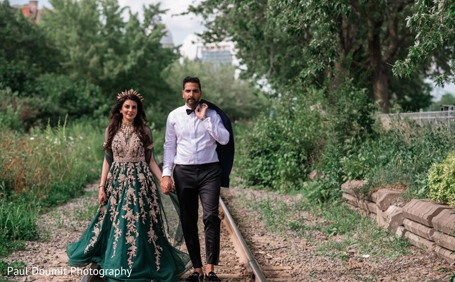 Adorable Indian couple walking and holding hands