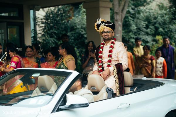 Indian groom on his white baraat vehicle.