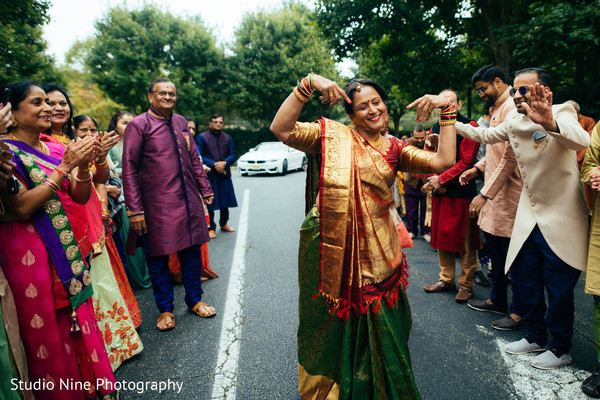 Indian wedding relative at baraat procession.
