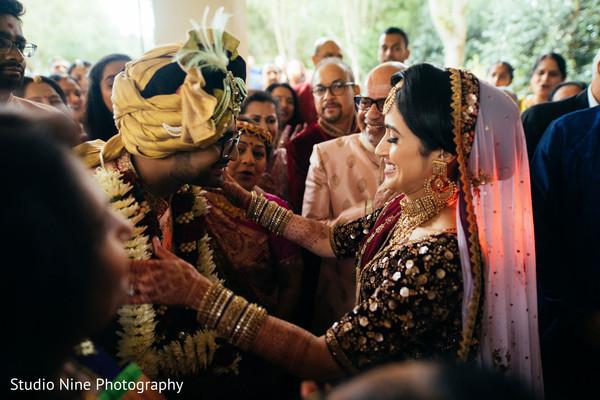 Indian bride putting garlan to groom at milni.