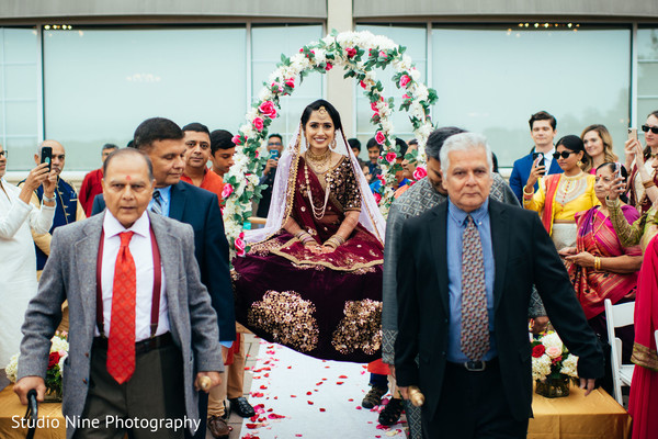 Indian bride making her entrance to her wedding ceremony.