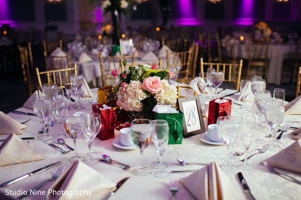 Indian wedding table decoration with flowers.