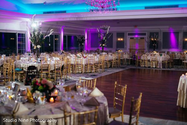 Indian wedding reception table setup and lights decor.