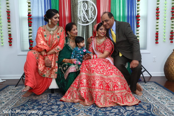 Indian bride sharring with relatives.