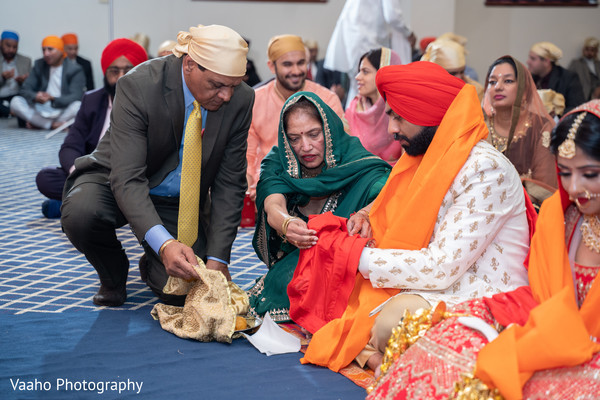 Raja and maharani during Sikh indian wedding ceremony ritual.