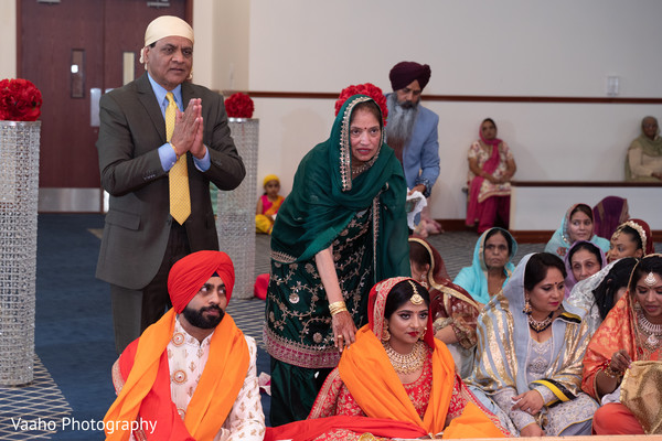 Indian wedding relatives at Sikh wedding ceremony.