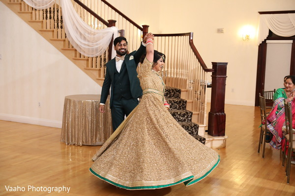 Indian bride and groom at reception dance.