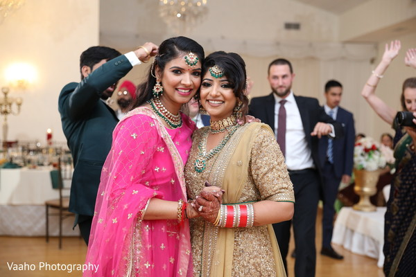 Indian bride with relatives at reception party.