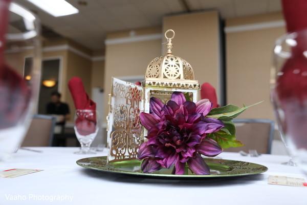Purple flower in a lanter Sangeet table decor.