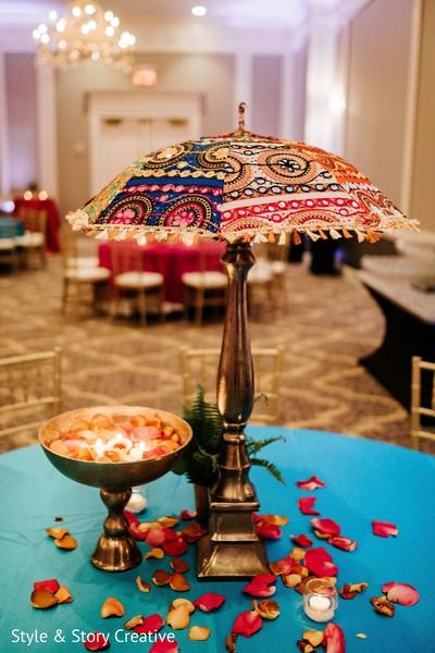 Orange rose petals at sangeet table decoration.