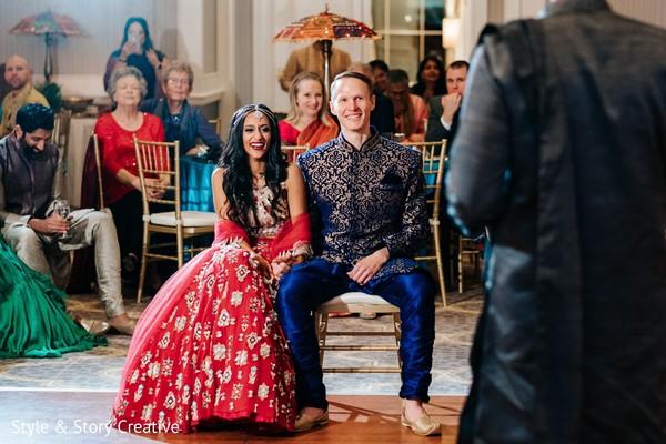 Indian couple at sangeet celebration photo.