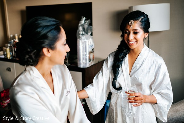 Indian bride and bridemaid getting ready.