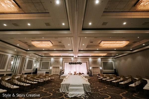 Indian wedding ceremony venue setup and decor.